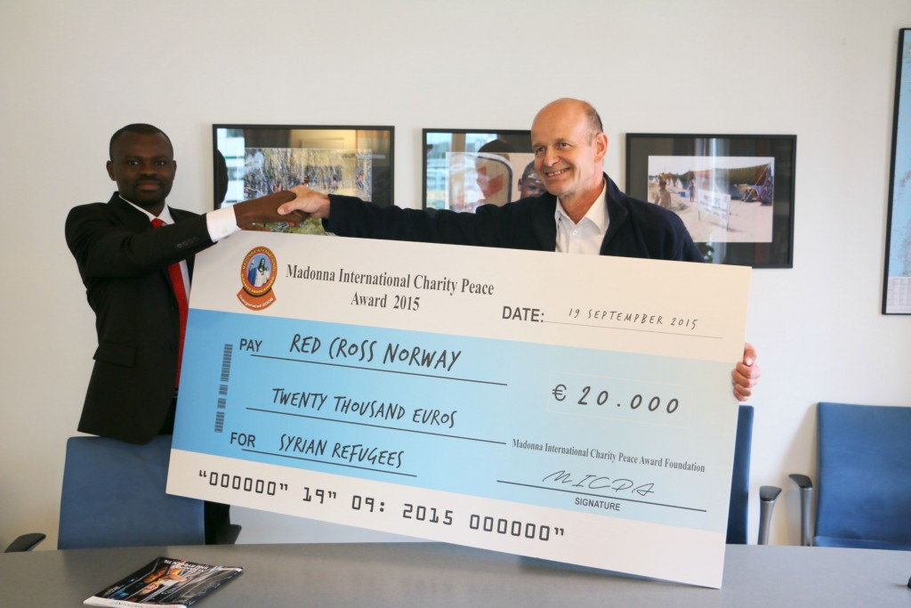 Mr. Martin Anagboso, Director of Public Relations MICPA presenting the award donation to  Mr. Sven Mollekleiv, President of Norwegian Red Cross at Norwegian Red Cross office in Oslo, Norway